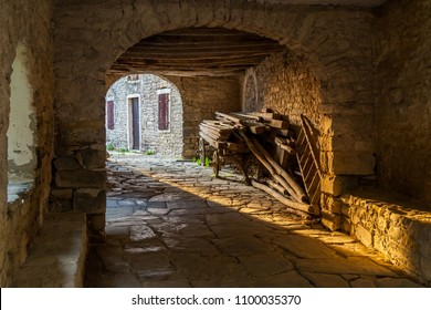 Passageway in old Mediterranean town Draguc - Istria, Croatia