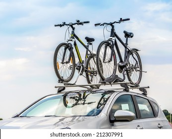 Passanger car with two bicycle mounted to the roof