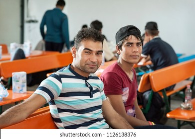 Passau, Germany - August 1, 2015: two brother from Syria at the registration area in Passau, Bavaria.
