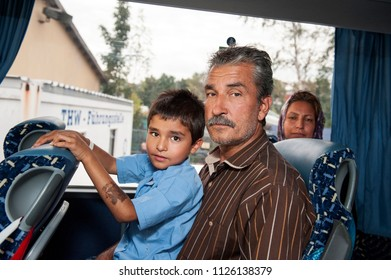 Passau, Germany - August 1, 2015: Family from Syria in the bus on the way from Passau. They are seeking asylum in Europe