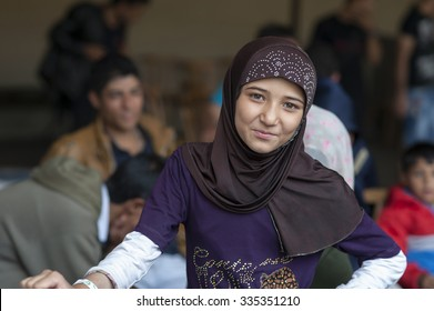 Passau, Germany - August 1, 2015: Syrian refugee girl at a camp in Passau. The police and several organisations try to push them through registration fast in order to manage the critical situation