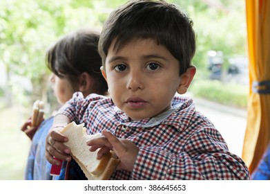 Passau, Germany - August 1, 2015: A young boy  from Syria in the bus on the way from registration center in Passau, southern Germany