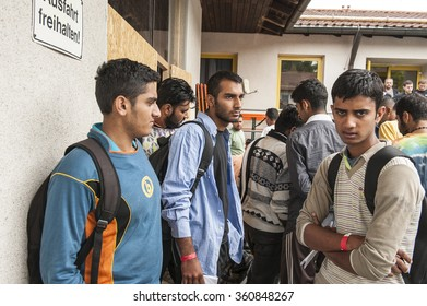 Passau, Germany - August 1st, 2015: Syrian refugee boys waiting for registration at a camp in Passau, Germany