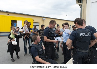 Passau, Germany - August 1st, 2015: The police take the information from refugees in the temporary registration center for migrants and refugees in the southern border town of Passau German