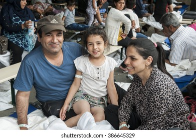 Passau, Germany - August 1st, 2015: Syrian refugee family at a camp in Passau, Germany