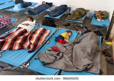 Passau, Germany - August 1st, 2015: Refugees sleep and wait in a hiking registration center in Passau, southern Germany