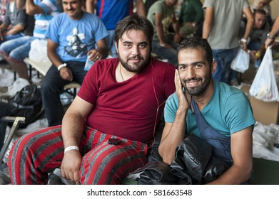 Passau, Germany - August 1st, 2015: Two friends from Syria at the registration area in Passau, Bavaria.
