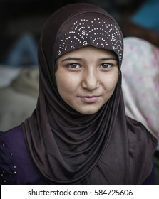 Passau, Germany - August 1st, 2015: Syrian refugee girl at a camp in Passau, Germany. The several organisations try to push them through registration fast in order to manage the critical situation