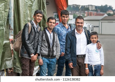 Passau, Germany - August 2, 2015: Family Shahbazi from Afghanistan waiting for registration at a camp in Passau, Germany