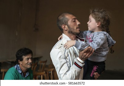 Passau, Germany - August 2, 2015: Father and his daughter from Syria in migrant registration center in Passau, southern Germany