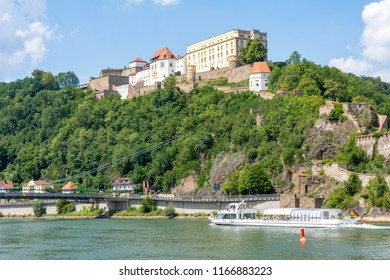 PASSAU, GERMANY - JULY 14: Ship on the Danube river below the Veste Oberhaus fortress in Passau, Germany on July 14, 2018. Foto taken from Donaukai with view to the fortress.