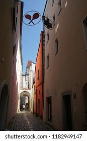 PASSAU, GERMANY - SEP 8, 2016 - Narrow street with Clock Tower of Town Hall,  Passau, Germany