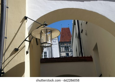 PASSAU, GERMANY - SEP 8, 2016 - Narrow street with shopkeepers and artists signs,  Passau, Germany