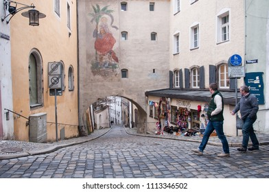 PASSAU, GERMANY - SEPTEMBER 28, 2012:  Tourists people walking through the narrow streets at city of Europe.