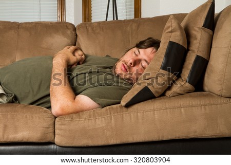uncomfortable couch old brown passed out in an uncomfortable spot on the couch out uncomfortable spot on couch stock photo edit now