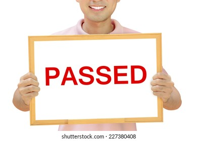 PASSED sign on whiteboard held by smiling man - examination & evaluation concept