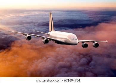 Passenger aircraft in flight. Airplane flies high in the sky over the sunset clouds.