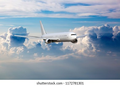 Passenger aircraft in flight. The plane flies high in the sky above the clouds.