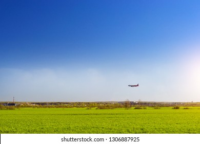 Passenger aircraft landing on runway in airport Pulkovo. Jet aircraft in sky over the field. Passenger and cargo transportation industry at the major international airport of St. Petersburg, Russia