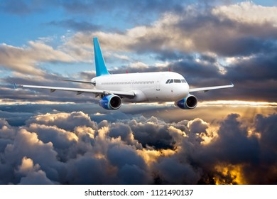 Passenger aircraft in the sky. Airplane flying high above the storm clouds.