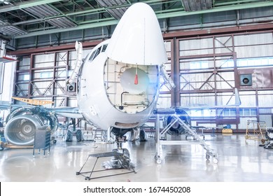 Passenger aircraft under maintenance. Checking mechanical systems of airplane for flight operations. Front view
