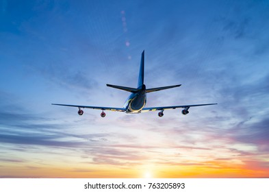 passenger airliner flying over the sea against backdrop of the setting sun
