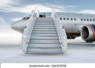 Passenger airplane with a boarding stairs on the airport apron isolated on bright background with sky