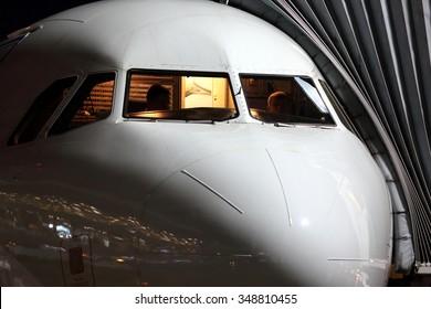 Passenger airplane cockpit in night.