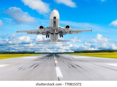 Passenger airplane fly up over take off runway from airport