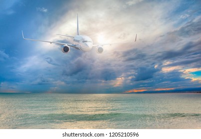 Passenger airplane flying above sea on stormy dark sky