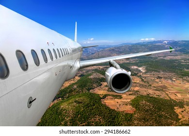 Passenger airplane flying over the ground