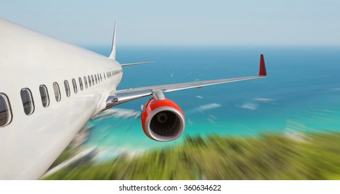passenger airplane flying over the sea