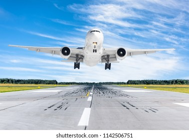 Passenger airplane landing at in good clear weather with a blue sky on a runway