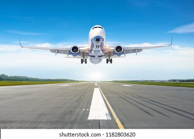Passenger airplane landing at in good clear weather with a blue sky clouds on a runway