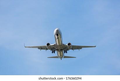 Passenger airplane landing over blue sky