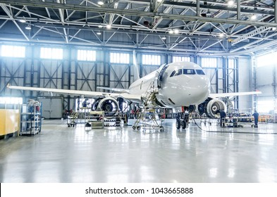Passenger airplane on maintenance of engine and fuselage check repair in airport hangar