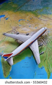 Passenger Airplane on Top of Map