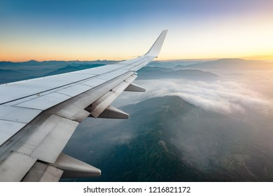 Passenger airplane wing in flight to the destination