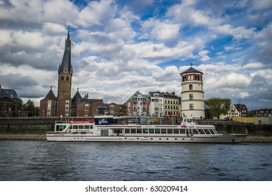 passenger boat Inland shipping on the rhein river by Dusseldorf with a view at the city Dusseldorf Germany April 2017