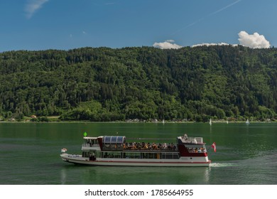 Passenger boat on Ossiacher see near Villach town in summer hot blue sky day