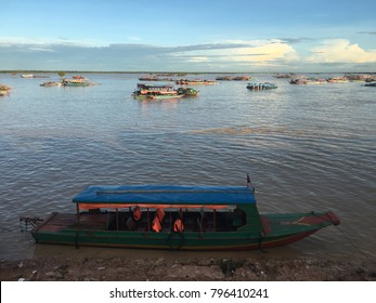 Passenger boat waiting by the bank of Tonle sap Combodia