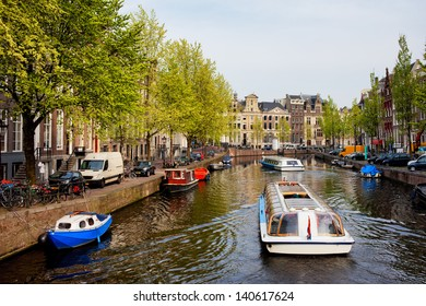 Passenger boats on canal tour in the city of Amsterdam, Holland.