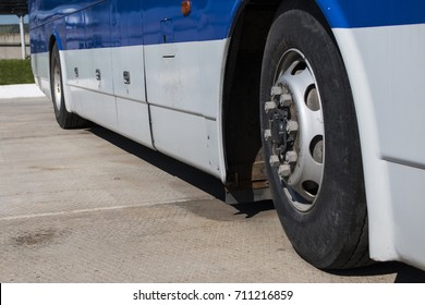 passenger bus is standing with at the bus stop