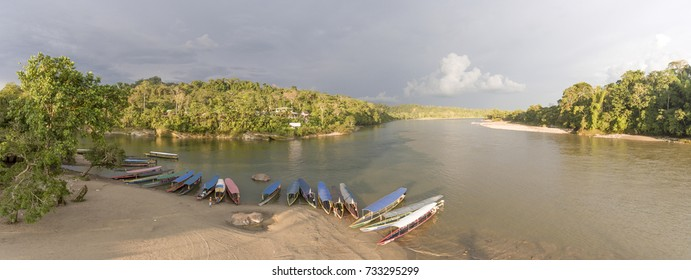 Passenger canoes on the beach beside the Rio Napo, near Misahualli village, a popular destination for adventure tourism in the Ecuadorian Amazon.