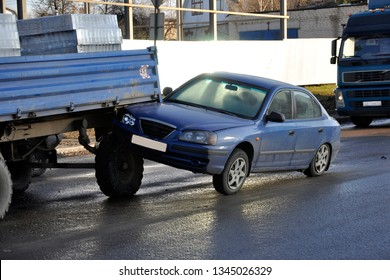 passenger car collided with a tractor. horizontal photo.