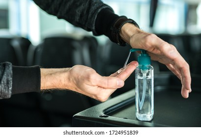 Passenger disinfects his hand with sanitizer on the bus, compliance with hygiene regulations on public transport, because of the coronavirus, covid19 contagion.