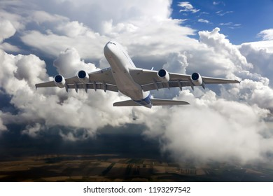 Passenger double decker aircraft in flight. White passenger plane is gaining height.
