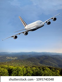 Passenger double decker plane in flight. Airplane fly high above the green hills. Front view of inclined aircraft.