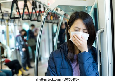 Passenger feeling unwell with face mask inside train compartment