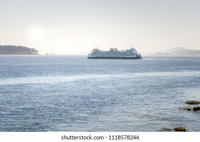 Passenger Ferry Leaving a Harbour on a Foggy Summer Morning